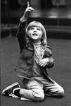 75-460; Boy Pointing Upward