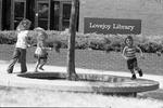78-96; Young Children Running Around Tree