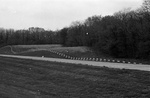 """79-356; Site-specific Sculpture by Christine Million Consisting of Highway Barricades """"Protecting"""" a Furrow of Planted Soybean Seed"""