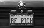 "83-366; ""Be Rich"" License Plate in Parking Lot"