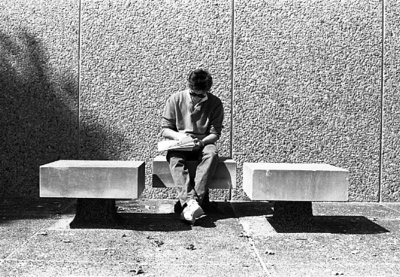 85-65; Student Reading Outside Library