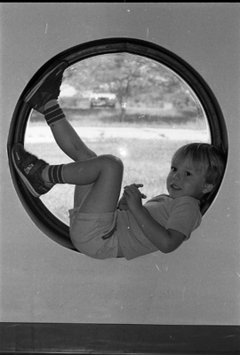 86-10; Early Childhood Center Student in Window